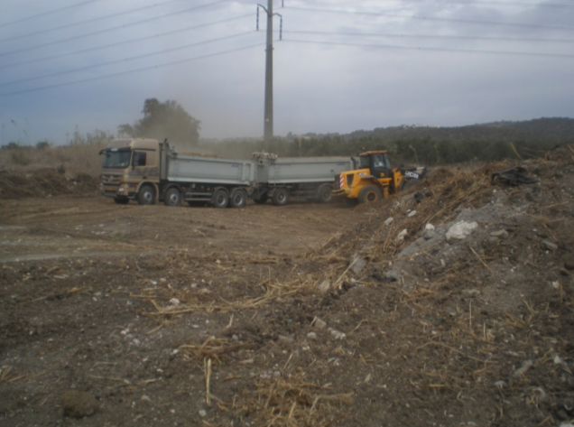 Loading dry sludge and removal to landfill site